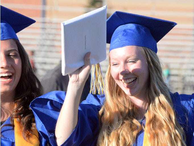 Buena High School graduate Courtney Curcio celebrates after receving her diploma during commencement ceremonies on Friday, June 20, 2014.  Staff photo/Charles J. Olson