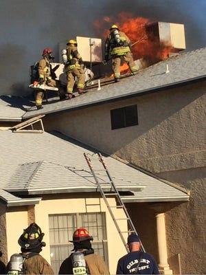 Fire crews fight a house fire in Gilbert.