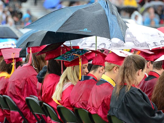Even the rain couldn't stop these seniors from sharing one last moment in the rain Saturday at Satellite Beach High School.