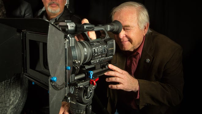 Las Cruces City Councilor Gill Sorg looks through a camera's eyepiece at Doña Ana Community College during a gathering of members of the Film Las Cruces board in 2016.