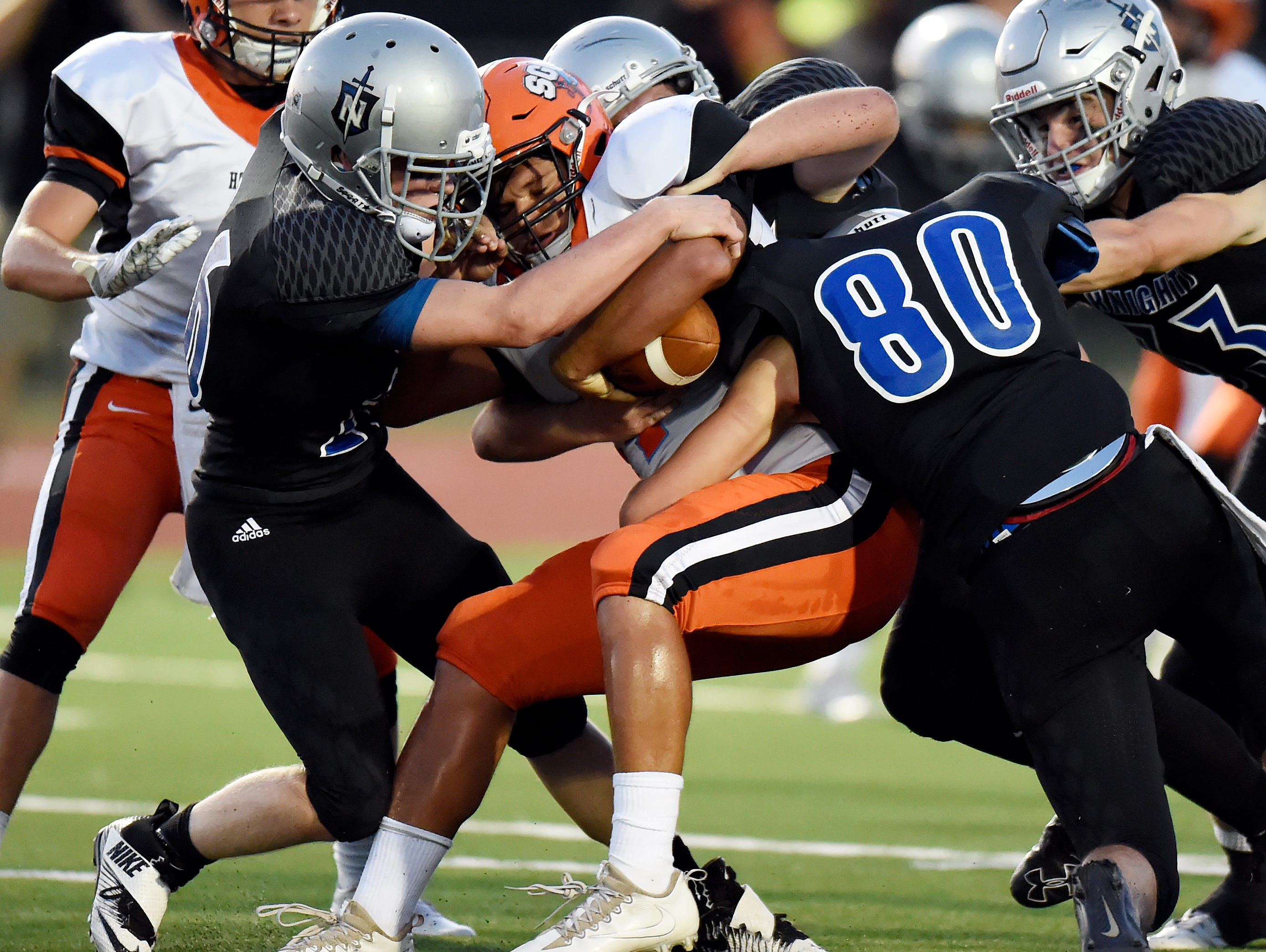 Nolensville linebacker's Connor Rigsby, left, and Tim Stayskal (80) sack South Gibson quarterback Dustin Moore (14) during the first half on Friday, Sept. 2, 2016, in Nolensville, Tenn.
