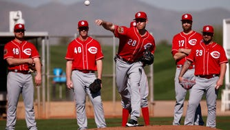 Cincinnati Reds starting pitcher Anthony DeSclafani (28) practices pick-off moves during Cincinnati Reds spring training, Thursday, Feb. 16, 2017, at the Cincinnati Reds player development complex in Goodyear, Arizona.