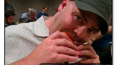 Todd Mills tastes for the first time a Doritos Locos Taco in the Taco Bell test kitchen.