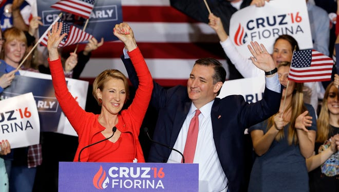 Republican presidential candidate Sen. Ted Cruz, R-Texas, and former Hewlett-Packard CEO Carly Fiorina wave during a rally in Indianapolis, Wednesday, April 27, 2016, when Cruz announced he had chosen Fiorina to serve as his running mate.