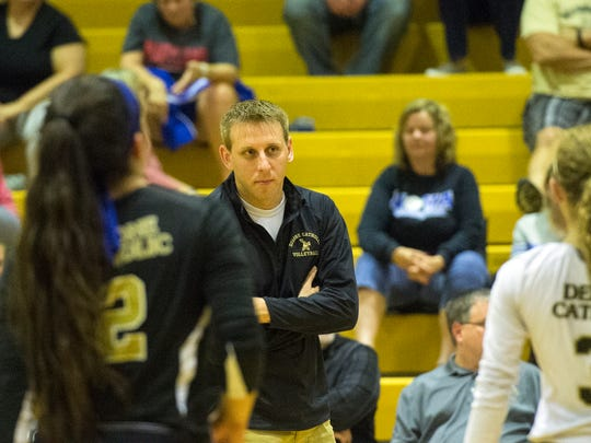 Delone Catholic head coach Jason Leppo speaks with his team during the Squirettes match against York Catholic, Thursday, October 5, 2017. The Delone Catholic Squirettes have depended on depth this season, helping the team stay in the No. 1 spot in YAIAA Division III standings.