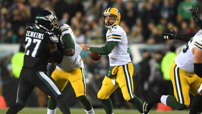 Nov 28, 2016; Philadelphia, PA, USA; Green Bay Packers quarterback Aaron Rodgers (12) looks to pass in the fourth quarter against the Philadelphia Eagles at Lincoln Financial Field. Green Bay defeated Philadelphia 27-13.  Mandatory Credit: James Lang-USA TODAY Sports