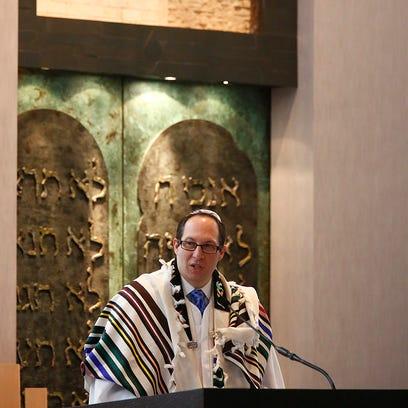 Rabbi Adam Miller speaks from the pulpit Wednesday,