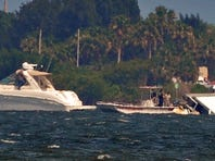Four people , some seen her at right, were rescued from atop a boat that capsized on the Banana River north of the Pineda Causeway, west of Patrick Air Force Base, Monday afternoon.