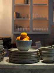 A bowl of tangerines on the counter at Monarch and