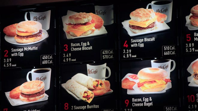 In this Sept. 12, 2012 file photo, items on the breakfast menu, including the calories, are posted at a McDonald's restaurant in New York.