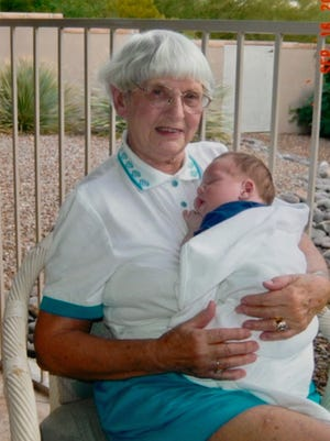 """Mary """"Jane"""" Kelly with her grandchild."""