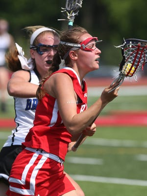 Red Hook's Kaleigh DelGuidice tries to get around Bronxville's Elie Walsh during a girls lacrosse state regional playoff game at Fox Lane High School in Bedford on Wednesday. Bronxville won the game 17-4.