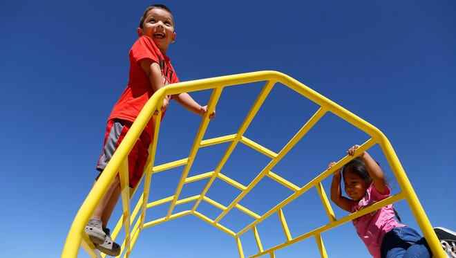 Arian Sanchez, left, and Kaysen Thomas play together Thursday at A Gold Star Academy on Crouch Mesa.