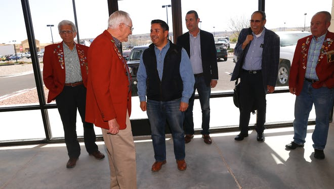 U.S. Rep. Ben Ray Luján, third from the left, is greeted by guests Wednesday during a ribbon-cutting ceremony at the Farmington Crossing shopping center.