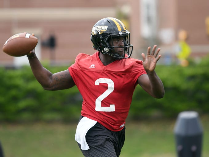 Southern Miss quarterback Keon Howard throws the ball