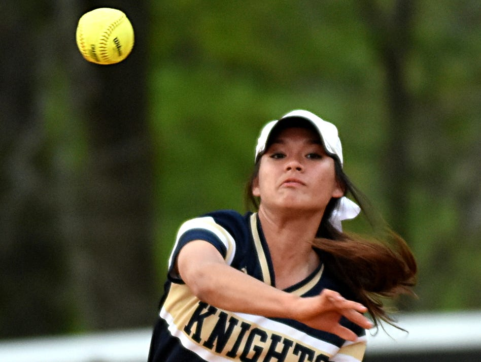 Pope John Paul II High junior shortstop Alexis Williams throws to first base for a third-inning putout.