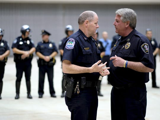 Knoxville's Chief of Police, David Rausch, left, speaks