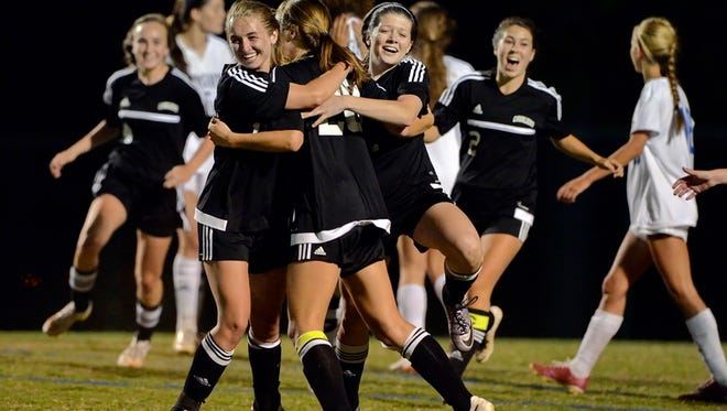 Christ Church players celebrate after defeating St. Joseph's 3-2 on penalty kicks in the Class AA/A Upper State final Monday night.