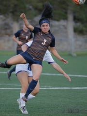 UTEP sophomore Jackie Soto heads a ball earlier this season. Soto moved from forward to defense and had an outstanding game Sunday night in UTEP's 4-1 win over New Mexico State.