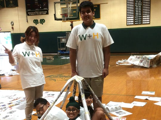 Eighth-grade students at The Wardlaw-Hartridge School in Edison started the new academic year with a team building activity. On the first day of school, right after Convocation, the students were asked to build a self-standing shelter, in an hour, using only newspapers and tape. Ten minutes were dedicated to planning and the rest of the time for the building. During the following advisory meetings, the students discussed the working process, the challenges they faced, and their achievements.