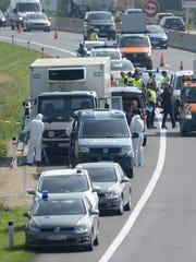 Forensic experts investigate a truck in Parndorf, Austria,