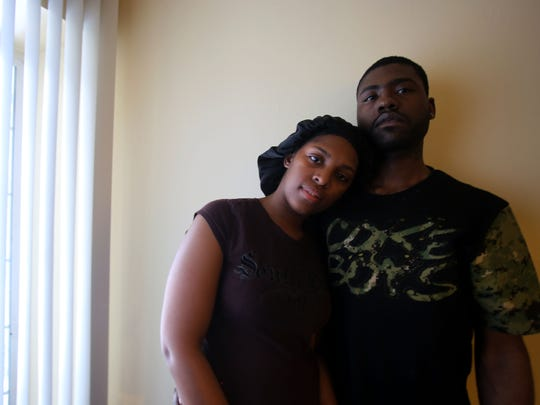 Adrian Tubbs and her fiance, Jamel Witcher, Sr., in 2014 grieve the loss of their 4-year-old son, Jamel Witcher, Jr., at their home on Detroit's west side. He was shot accidentally Thursday, Jan. 16, 2014,  by his 4-year-old cousin.