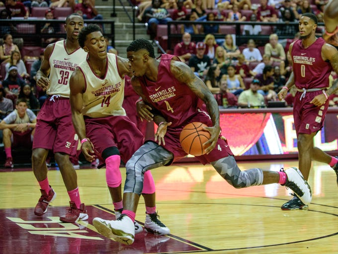 Dwayne Bacon (4) takes the ball to the hoop as Terance
