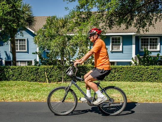 On Oct. 31, when the leaves are falling along with the temperatures, the Bartholomews close up their cottage and head south to their southern paradise in Jupiter at the Villas of Ocean Dunes, says Richard Bartholomew pictured bicycling.
