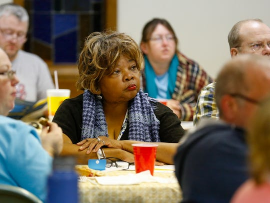 Roxanne Bedell-Taylor, who is a member of the Neighborhood Advisory Council, listened to a bond issue presentation by Springfield school board members in March, prior to the election.
