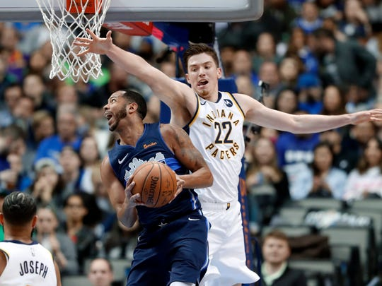 Dallas Mavericks guard Devin Harris (34) goes up for a shot as Indiana Pacers forward T.J. Leaf (22) and Cory Joseph, bottom left, defend in the first half of an NBA basketball game in Dallas, Wednesday, Feb. 27, 2019. (AP Photo/Tony Gutierrez)