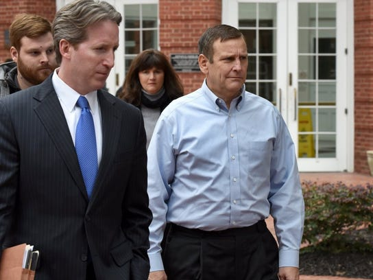 Former Pilot Flying J Vice President of Direct Sales Scott Wombold, right, leaves federal court.