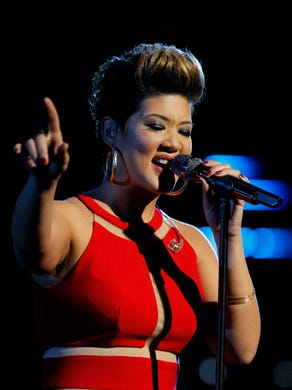 """Jamaican contestant Tessanne Chin won Season 5 alongside coach Adam Levine, performing a memorable rendition of Whitney Houston's """"I Have Nothing."""""""