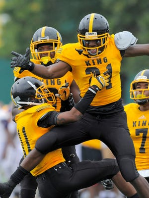 Detroit King's LaVert Hill celebrates with teammates after intercepting a pass late in the game.