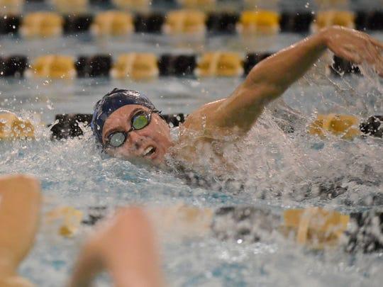 IHA's Isabelle Arevalo swims the 100-yard freestyle