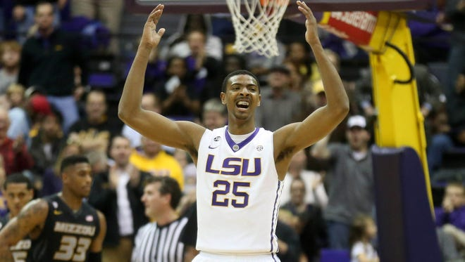 LSU Tigers forward Jordan Mickey (25) raises his hands to the crowd in the second half against the Missouri Tigers in a 2014 game.