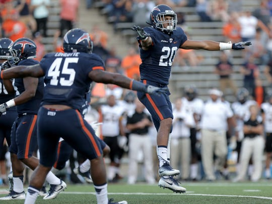 UTEP defensive back Nik Needham signals incomplete