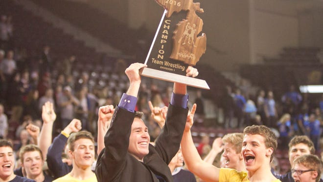 Hartland wrestling coach Todd Cheney celebrates the Eagles' 2016 state Division 1 championship, which was achieved after five runner-up finishes.