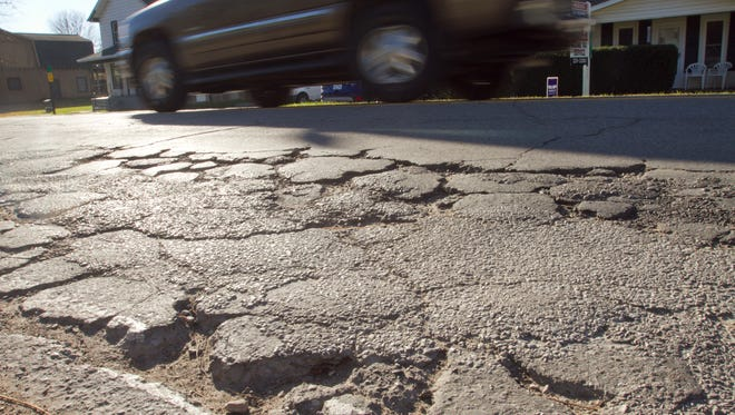Hamburg Road in the village of Hamburg shows the need for repairs. Millions in repairs to local paved roads across Livingston County are under consideration by township and Livingston County Road Commission officials.