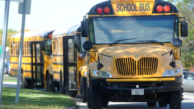 School buses line up to pick up students at Sabish Middle School on Sept. 25, 2014.