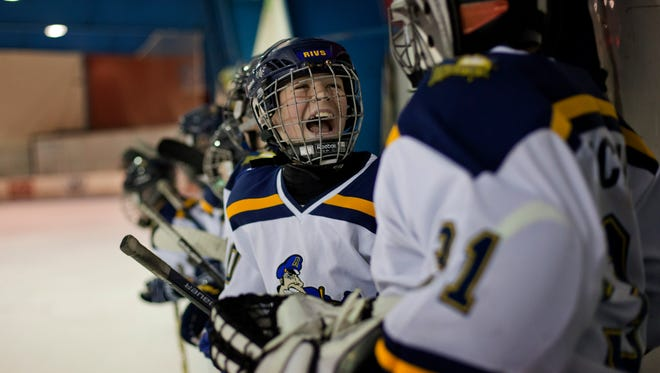 Peoria Rivermen's Jacob Rusk celebrates with teammates after a Streetsville Tigers goal was reversed during a PeeWee AA Silver Stick hockey game Thursday, January 22, 2015 at Glacier Pointe in Port Huron Township. The Tigers went on to score again in the final seconds to tie the game.