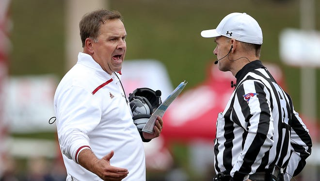 Indiana Hoosiers head coach Kevin Wilson,left, argues a call with NCAA referee John O'Neill,right, in the first half of their game. Oct 3, 2015; Bloomington, IN, USA; [CAPTION] at Memorial Stadium. Mandatory Credit: Matt Kryger-USA TODAY Sports