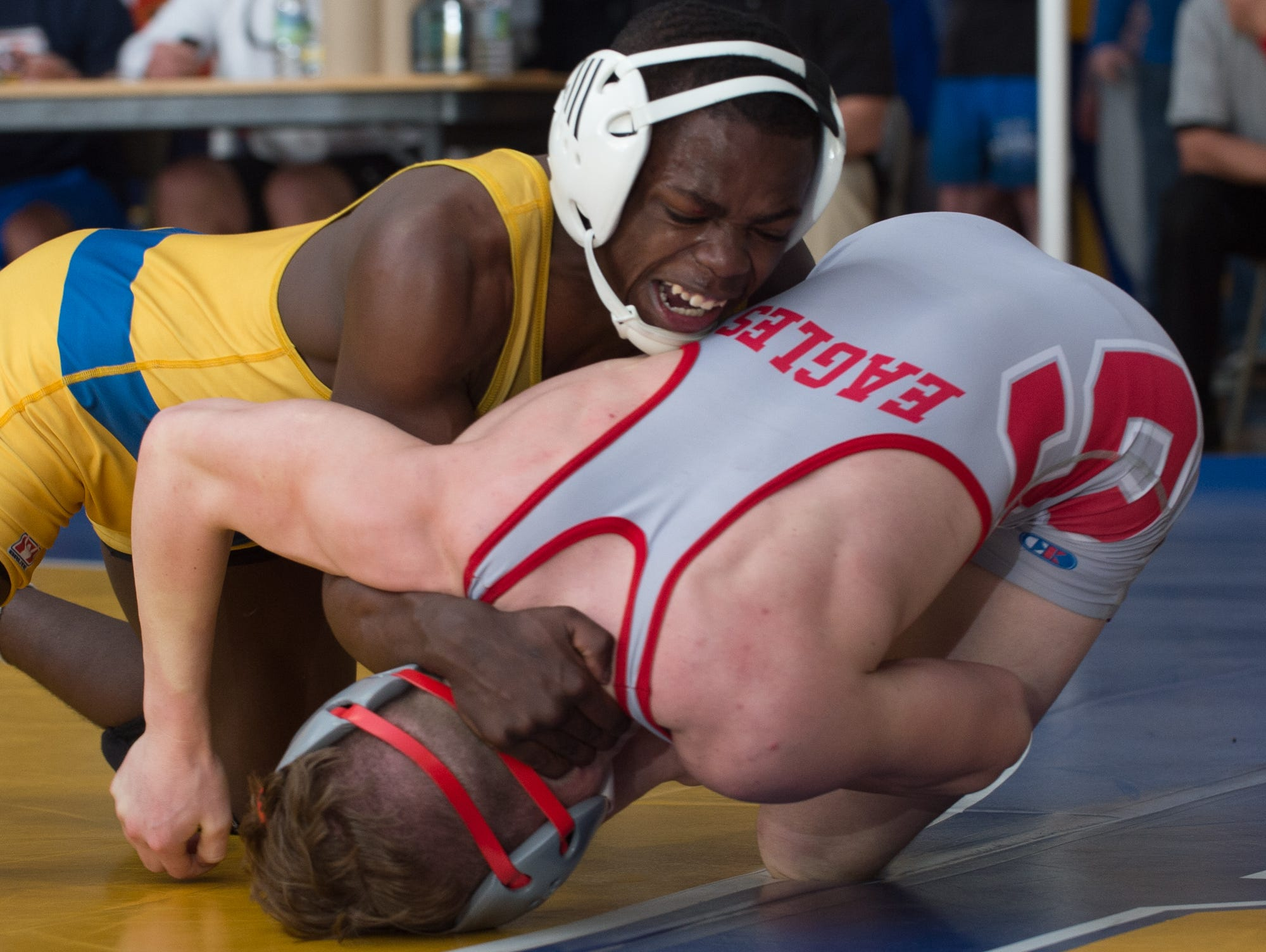 Sussex Central's Rashad Stratton works to roll Smyrna's Cole Sebastianelli on to his back in the 126 pound championship match at the Henlopen Conference wrestling tournament at Sussex Central High School.