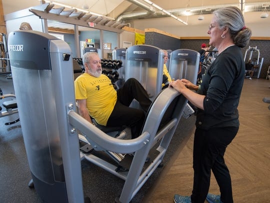 Hope Cochran, right, a YMCA instructor talks with Glenn Phillippi of Townsend, during his LIVESTRONG workout at the Middletown YMCA.