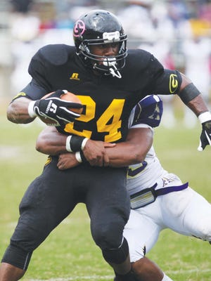 Grambling's Juwan Martin gets pulled down in action.