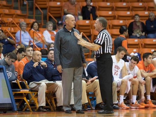 UTEP Assistant Coach Phil Johnson debates with a referee during the Miners' exhibition against the Cameron Aggies.