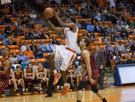 UTEP guard Tevin Caldwell (15) jumps to basket to attempt