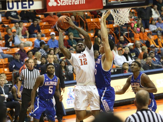 UTEP forward Terry Winn (12) shoots against the contact of UT-Arlington forward Jorge Bilbao (45).
