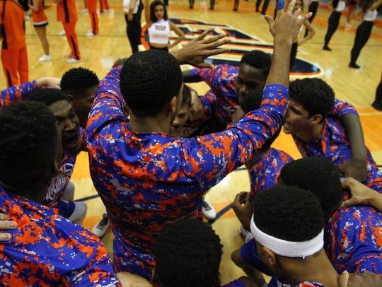 UT-Arlington dances in a pre-game huddle.