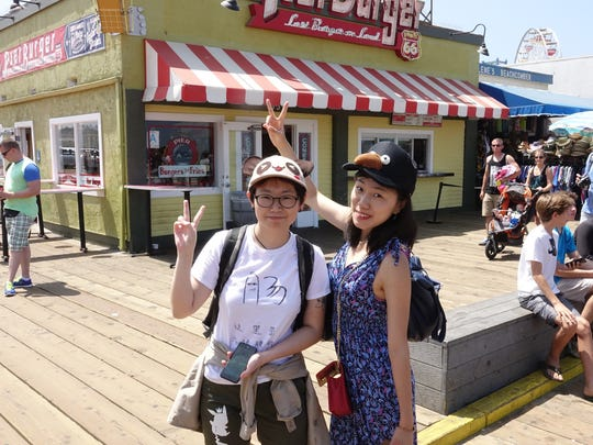 Yung Wong, left, a student from China, with friend