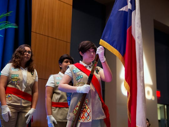 Alayna Osborne, 14 (right), with Girl Scout Troop 9626, presents the colors during the State of the City at the American Bank Center on Wednesday, March 28, 2018. The annual event is hosted by the United Corpus Christi Chamber of Commerce.